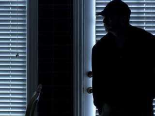 Two families assaulted in home invasions